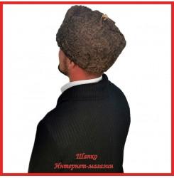 Мужская зимняя шапка-ушанка из каракуля
